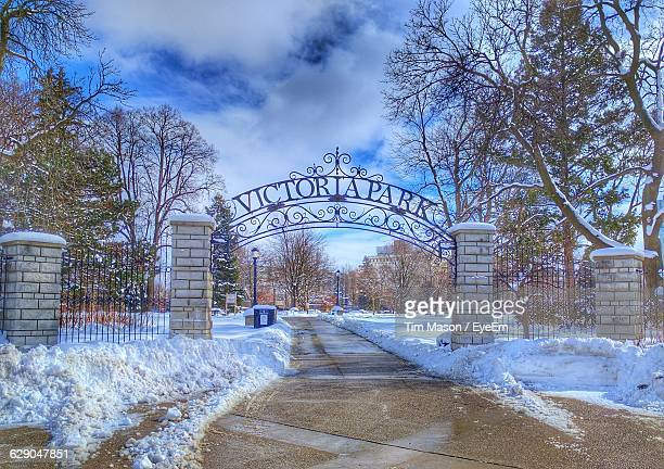 entrance gate of park during winter against sky - london ontario stock photos and pictures
