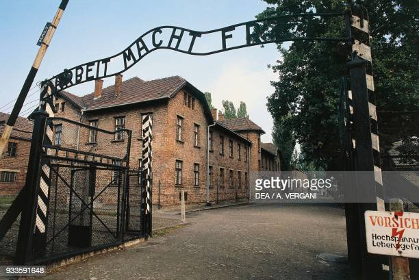 Entrance gate with the inscription Arbeit macht frei Auschwitz concentration camp Poland