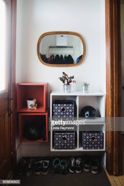 entrance hall with storage compartment and a cat inside - linda wilton stock pictures, royalty-free photos & images