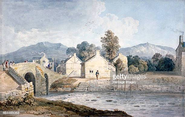 'Entrance into Keswick Cumberland' 19th century Figures stand on a bridge crossing the river village buildings can be seen across the river with...
