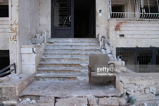 Entrance of a damaged building is seen after forces connected to the Ansar AlSharia operations center attacked buildings containing regime forces in...
