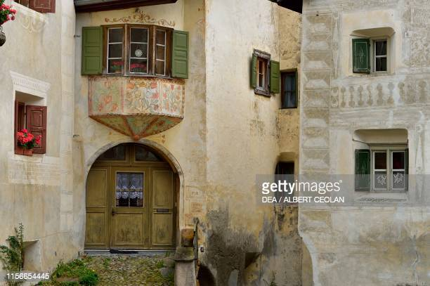 Entrance of a house with small bow window, Guarda, Scuol, Engadin, Canton of Graubunden, Switzerland.