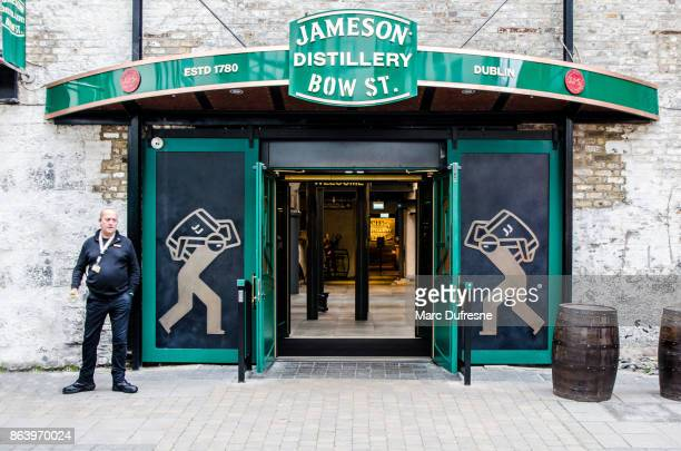 entrance of jameson distillery in dublin during day of autumn - doorman stock photos and pictures