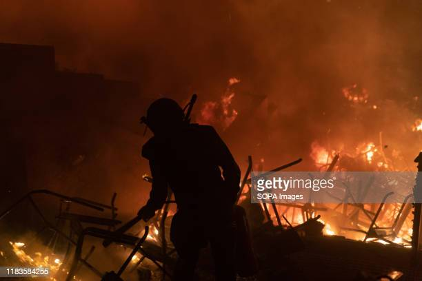 Entrance of Polytechnic University of Hong Kong is set on fire against police during the demonstration Police surround the Polytechnic University...