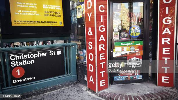 """entrance of the famous """"village cigars"""" store along 7th avenue in the west village, manhattan, new york city, usa - transportation building type of building stock photos and pictures"""