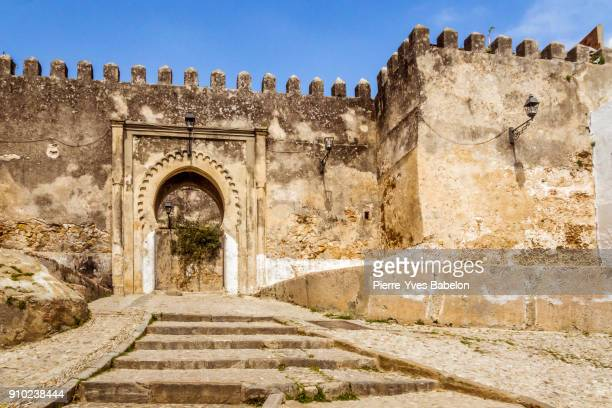 entrance of the kasbah - fortified wall stock photos and pictures