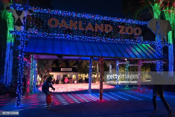 Entrance of the Oakland Zoo in Oakland California with elaborate Christmas lights display part of the annual Zoo Lights event December 27 2017