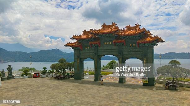 Entrance Of Wen Wu Temple Against Cloudy Sky