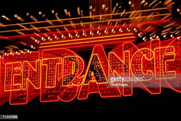 entrance sign lit up at night, las vegas, nevada, usa - neon letters stock photos and pictures