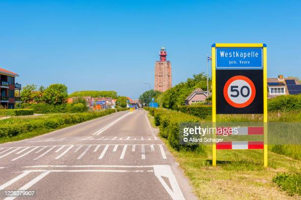 entrance sign to westkapelle zeeland netherlands - zeeland stock pictures, royalty-free photos & images