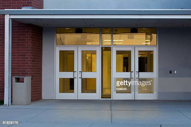 Entrance to a Modern Public School Building with Illuminated Interior