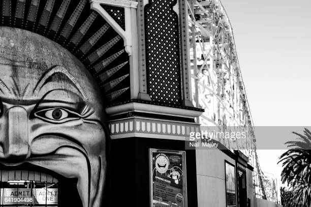 Entrance to amusement park with roller coaster ride (black and white)