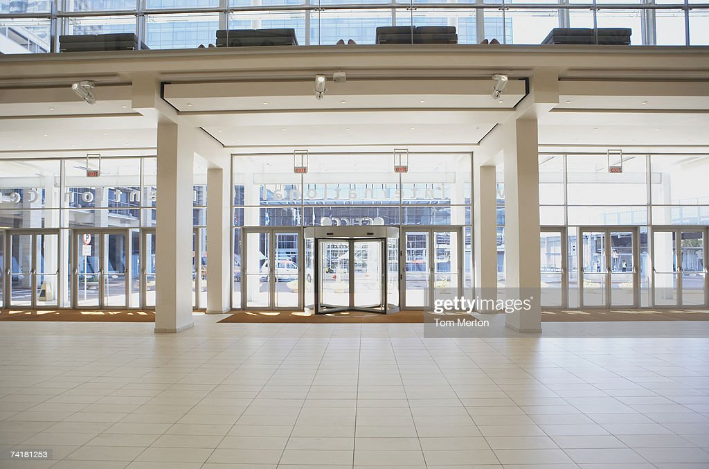 Entrance to building with light and large windows : Stock Photo