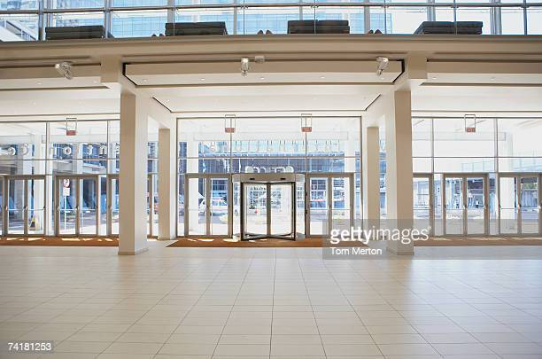 entrance to building with light and large windows - hotel lobby stock pictures, royalty-free photos & images