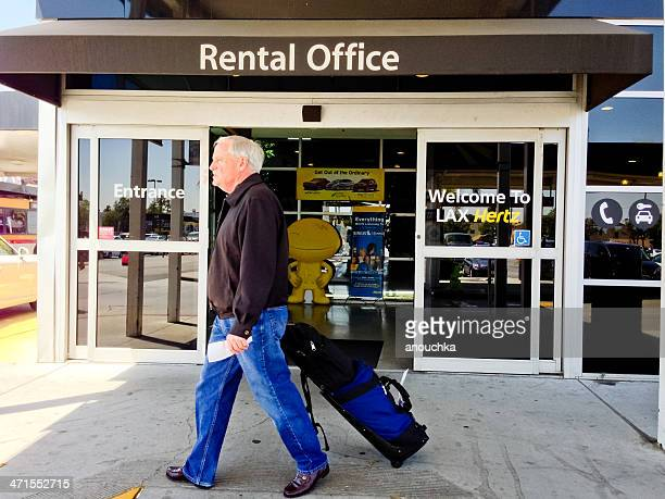 entrance to hertz car rental office at los angeles airport - hertz stock pictures, royalty-free photos & images