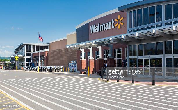 entrance to large walmart food supermarket or superstore in haymarket, virginia, usa - wal mart stock pictures, royalty-free photos & images