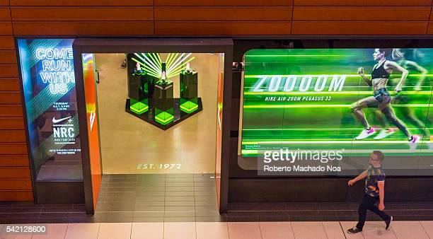 Entrance to Nike Store in Eaton Center The brand is advertising its new Nike Air Pegasus 33 shoes in green based design