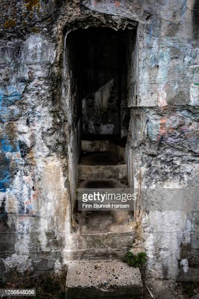 entrance to old german bunker in hvide sande denmark - finn bjurvoll stock pictures, royalty-free photos & images