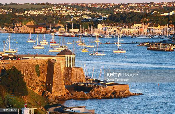 entrance to sutton harbour at sunset, plymouth, england, united kingdom, europe - harbour stock pictures, royalty-free photos & images