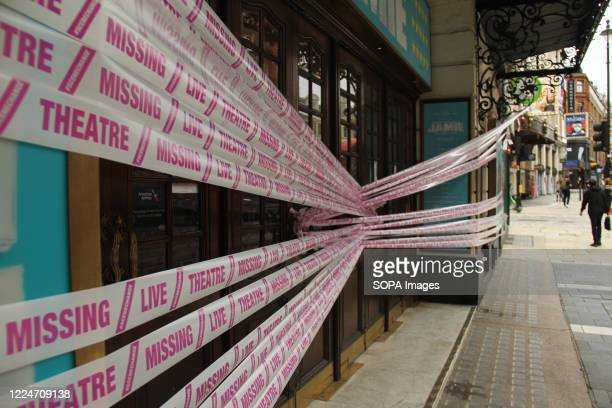 Entrance to The Apollo Theatre is pictured closed and wrapped in bright pink tape during the campaign. Some Theatres across the country were wrapped...