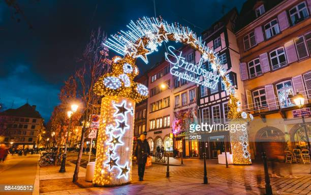 entrance to the capitale de noel on christmas time in strasbourg, france - strasbourg stock pictures, royalty-free photos & images