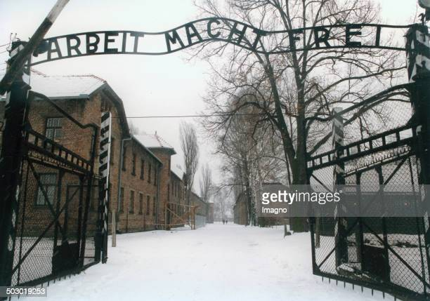 Entrance to the concentration camp Auschwitz-Birkenau. Poland. Photograph from 1995. .