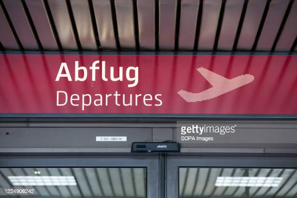 Entrance to the departures area at Schoenefeld Airport . Berlin Schoenefeld Airport is the secondary international airport of Berlin, located 18 km...