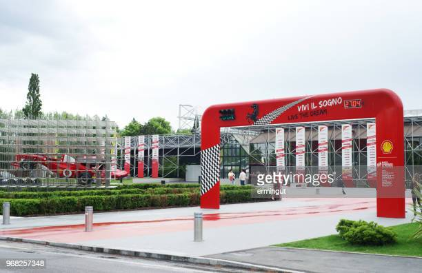 entrance to the ferrari museum in maranello, italy - maranello stock pictures, royalty-free photos & images