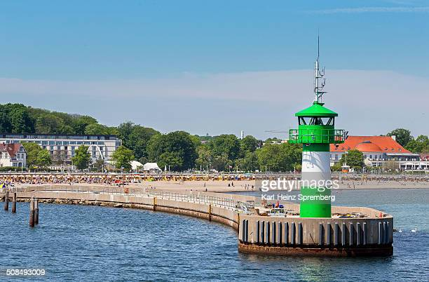 Entrance to the port with lighthouse and beach, Travemunde, Lubeck, Schleswig-Holstein, Germany