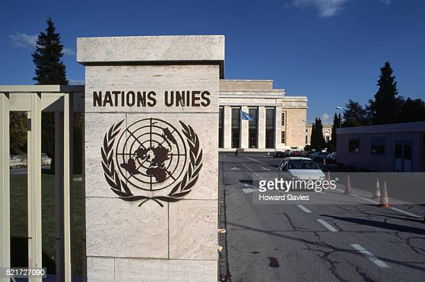 entrance to the united nations building in geneva - インターナショナルビル ストックフォトと画像