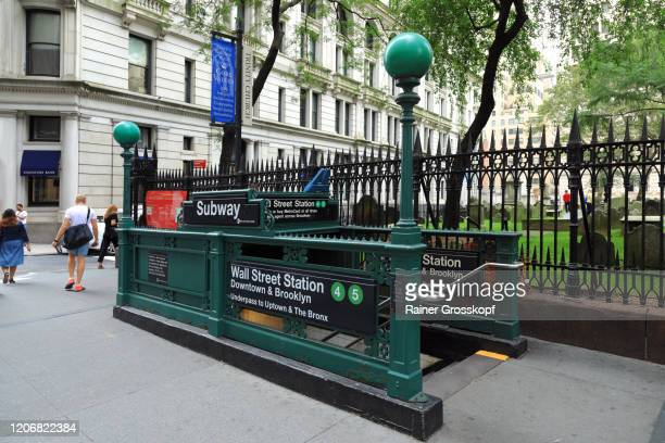 entrance to the wall street subway station in the financial district - rainer grosskopf stock pictures, royalty-free photos & images