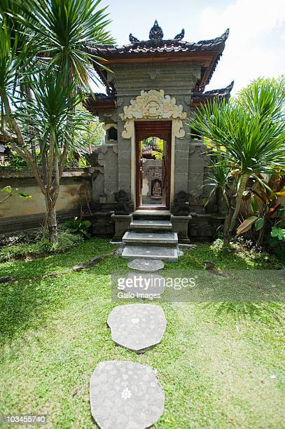 entrance to traditional balinese home, ubud, bali, indonesia - balinese culture stock pictures, royalty-free photos & images