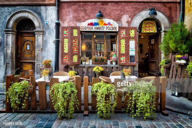 entrance to traditional polish restaurant located in warsaw's old town - warsaw stock pictures, royalty-free photos & images