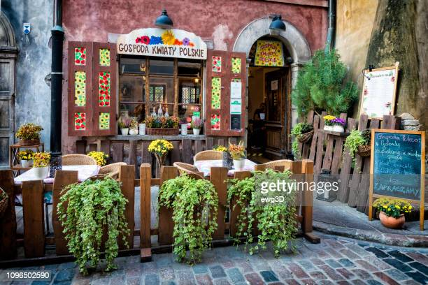 entrance to traditional polish restaurant located in warsaw's old town - polish culture stock pictures, royalty-free photos & images