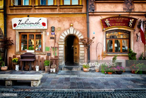 entrance to traditional polish restaurants located in warsaw's old town - warsaw stock pictures, royalty-free photos & images