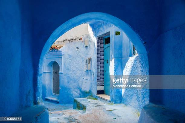 Entrance with arch in the courtyard of a typical house in the center of the medina of Chefchaouen, the blue village of Morocco. Chefchaouen, April...
