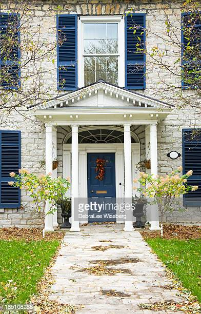 entrance with blue shutters - kingston ontario stock photos and pictures