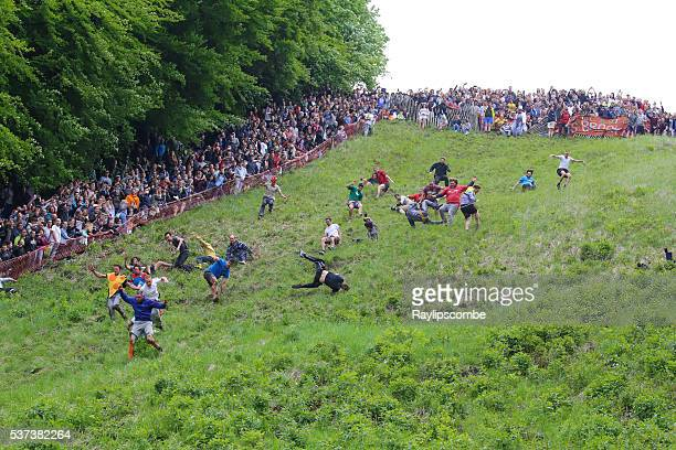 Entrants chasing the cheese at the 2016 'Cheese Rolling'