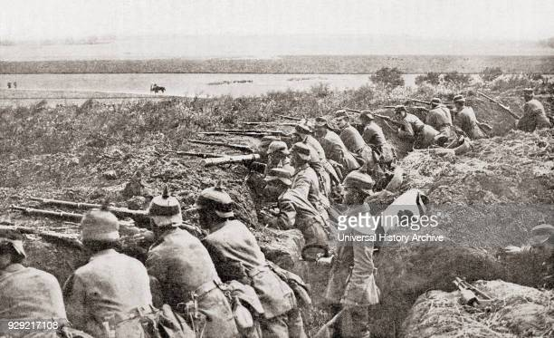 Entrenched German soldiers await the arrival of the Belgians during World War One From The History of the Great War published c 1919