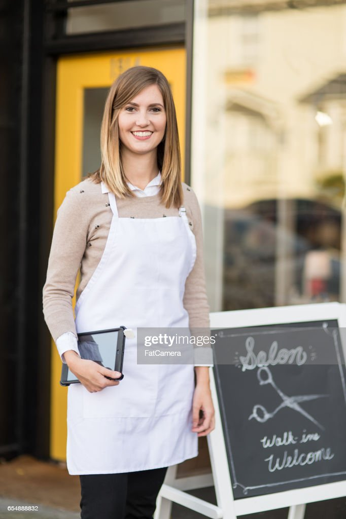 Entrepreneur And Owner Standing Outside Her Hair Salon High Res Stock Photo Getty Images