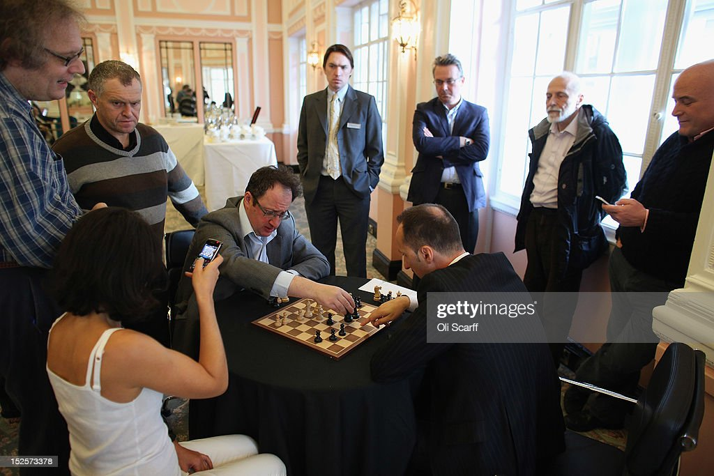 Entrepreneur Andrew Paulson (R) watches chess Grandmasters Boris Gelfand (4th L) and Veselin Topalov (4th R) analyse their match immediately after its conclusion at the World Chess London Grand Prix at Simpson's-in-the-Strand on September 22, 2012 in London, England. The event, which begins the 2012/13 World Chess Championship Cycle, runs until October 3, 2012 and takes place over 11 rounds. The London Grand Prix is the first tournament in an ambitious, high-profile rebranding of world chess by American-born entrepreneur Andrew Paulson whose intention is to regain the global popularity chess enjoyed in the 1970s with matches between American Bobby Fischer and the Soviet Union's Boris Spassky.