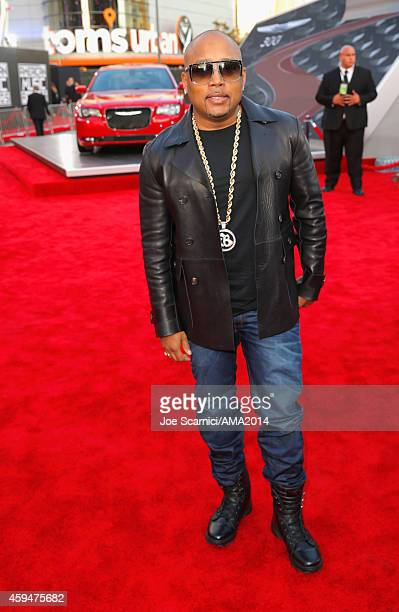 entrepreneur Daymond John attends the 2014 American Music Awards red carpet arrivals featuring the AllNew Chrysler 300S at Nokia Theatre LA Live on...