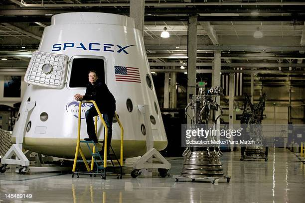Entrepreneur, engineer and inventor Elon Musk is photographed with the Dragon spacecraft at SpaceX headquarters for Paris Match on October 30 on 1...