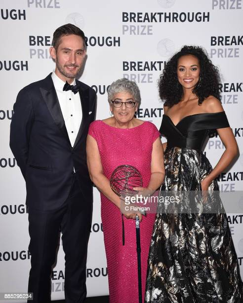Entrepreneur Kevin Systrom Breakthrough Prize Winner in Life Sciences Laureate Joanne Chory and Miss USA Kara McCullough pose backstage at the 2018...