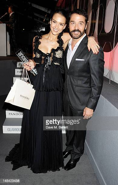 Entrepreneur Of The Year Jessica Alba and presenter Jeremy Piven pose at the Glamour Women of the Year Awards in association with Pandora at Berkeley...