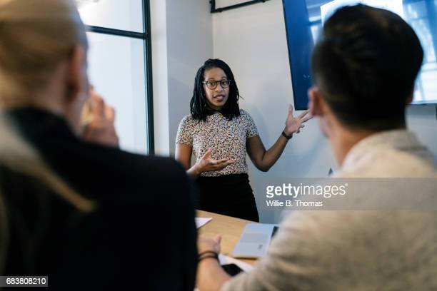 Entrepreneur Pitching Ideas At A Meeting At Co-working Space