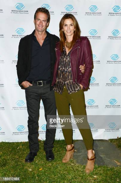 Entrepreneur Rande Gerber and his wife model Cindy Crawford arrive at the Malibu Boys And Girls Club Fundraiser to introduce the 2013 BGCM Youth of...