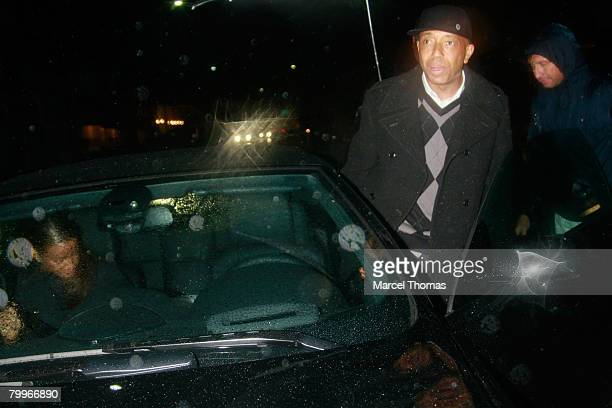 Entrepreneur Russell Simmons and galpal model Porschia Coleman leave Mr Chow's restaurant in Beverly Hills on February 21, 2008 in Los Angeles,...