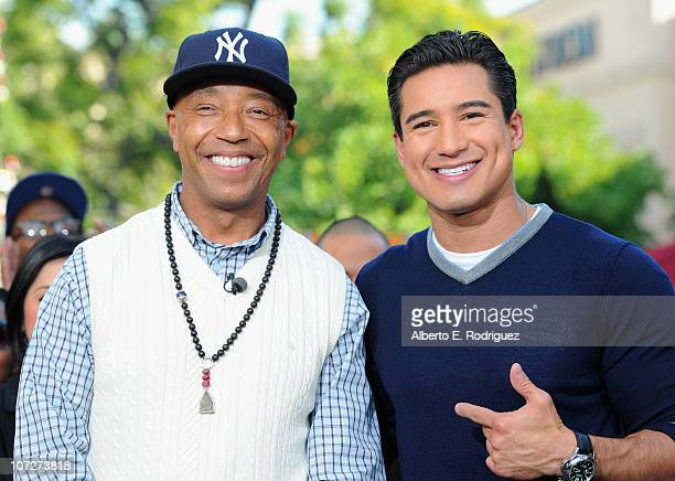 Entrepreneur Russell Simmons and TV personality Mario Lopez on the set of Extra at The Grove on December 2 2010 in Los Angeles California
