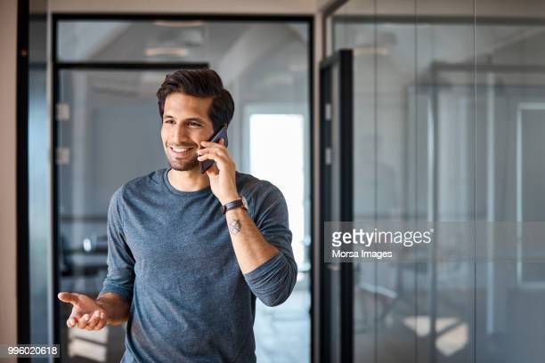 Entrepreneur talking on mobile phone at office